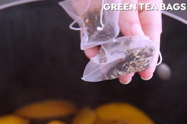 Add green tea bags to steep peach green tea