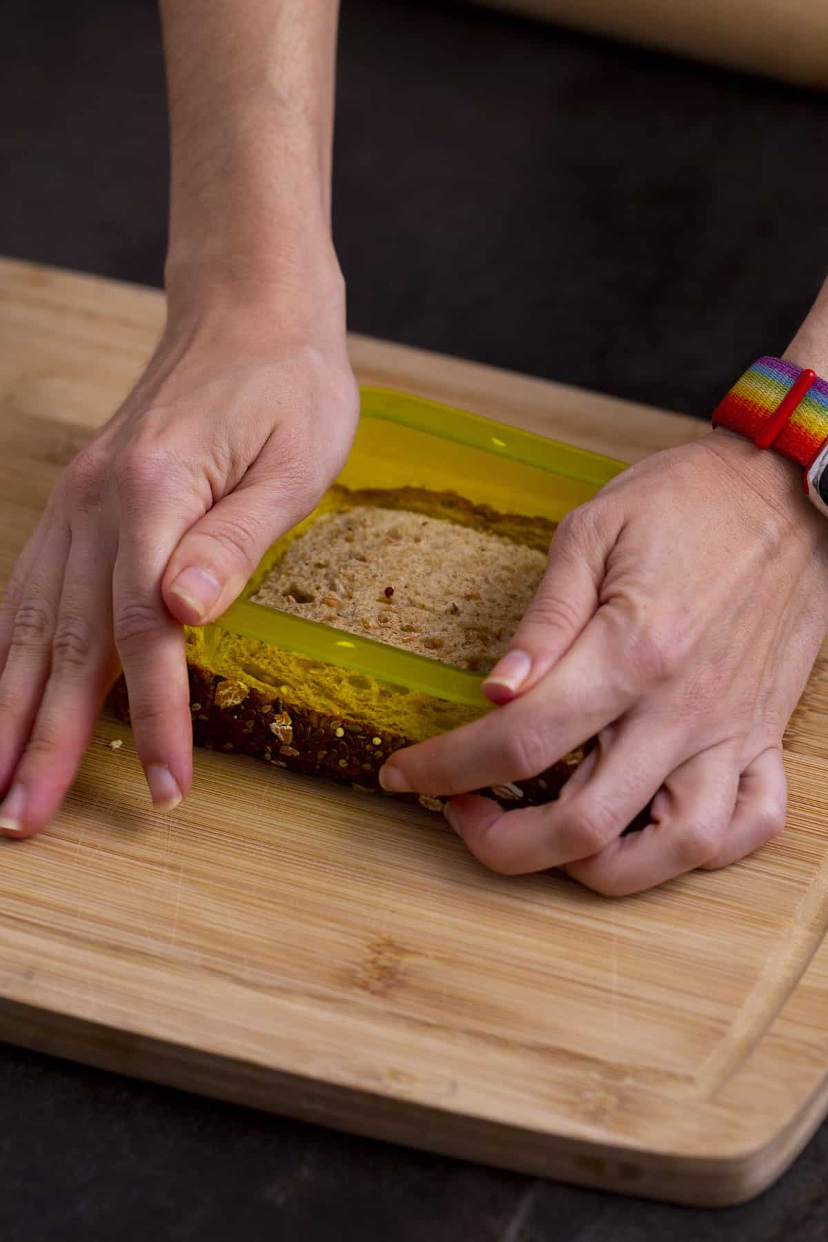 Press outer shape of sandwich sealer onto bread to cut sandwich and remove crusts.