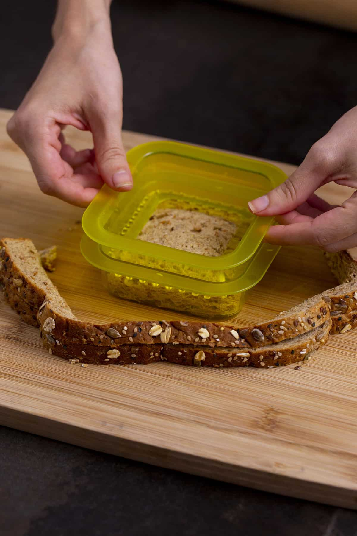 Use sealer to press edges of uncrustables sandwich until crimped and closed.