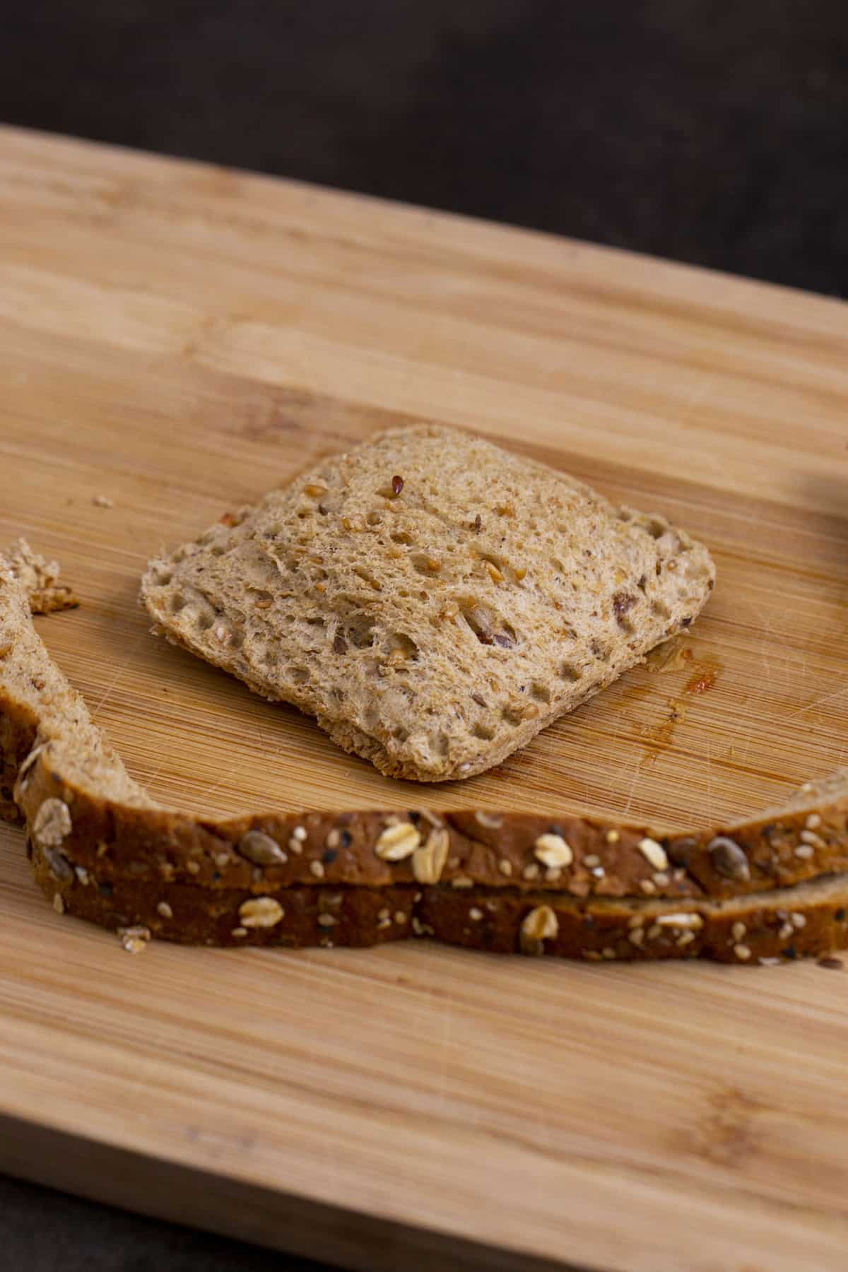 Remove sandwich sealer to reveal completed DIY uncrustables sandwich. Reserve crusts for homemade breadcrumbs, croutons, or snacking.