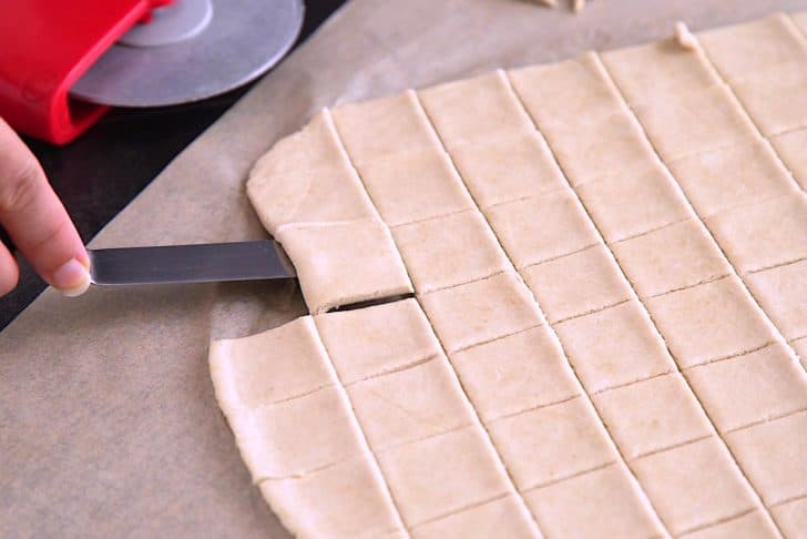 Cut rolled dough sheet into 1-inch rectangles and transfer to a lined baking sheet.