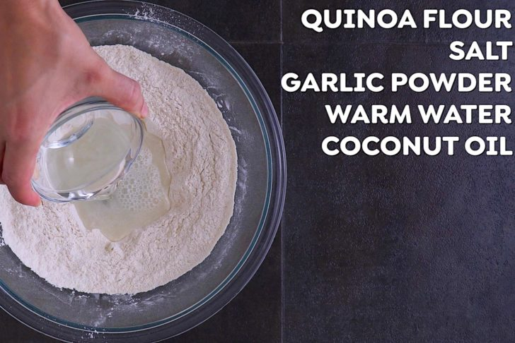 Combine quinoa flour and seasonings in a bowl. Create a well in the center, then add water and melted coconut oil. Mix with a wooden spoon to form a dough.