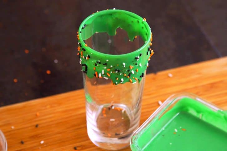 Add festive sprinkles onto frosting while it's still wet, then stand glass upright for a few minutes to give frosting a natural drip effect. Chill in the fridge to set.