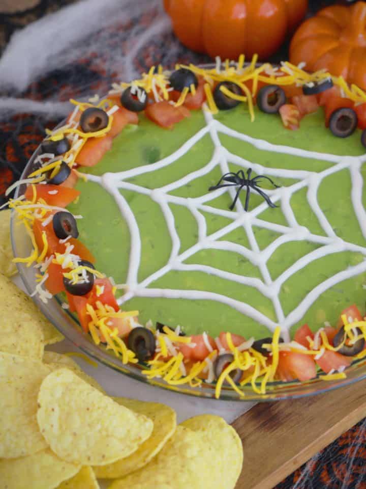 Halloween 7 Layer Dip, Halloween spider 7 layer dip, 7 layer dip Halloween style, 7 layer Mexican dip Halloween, Halloween spider web 7 layer dip, Halloween taco dip, spider web taco dip, Halloween party dips
