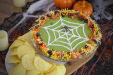 Halloween 7 Layer Dip, Halloween spider 7 layer dip, 7 layer dip Halloween style, 7 layer Mexican dip Halloween, Halloween spider web 7 layer dip, Halloween taco dip, spider web taco dip, Halloween party dips, how to make 7 layer dip