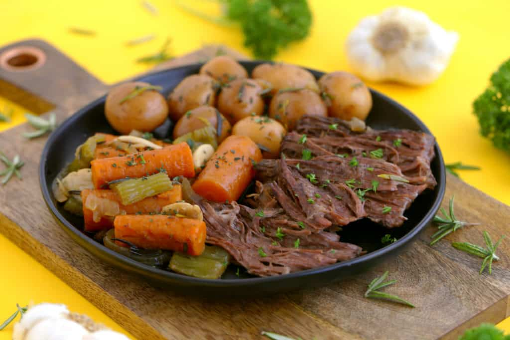 Dutch oven pot roast with potatoes and carrots, pot roast in oven, healthy one pot meals, how to make a pot roast in the oven, crock pot roast, healthy dinner ideas, pot roast dinner, healthy pot roast