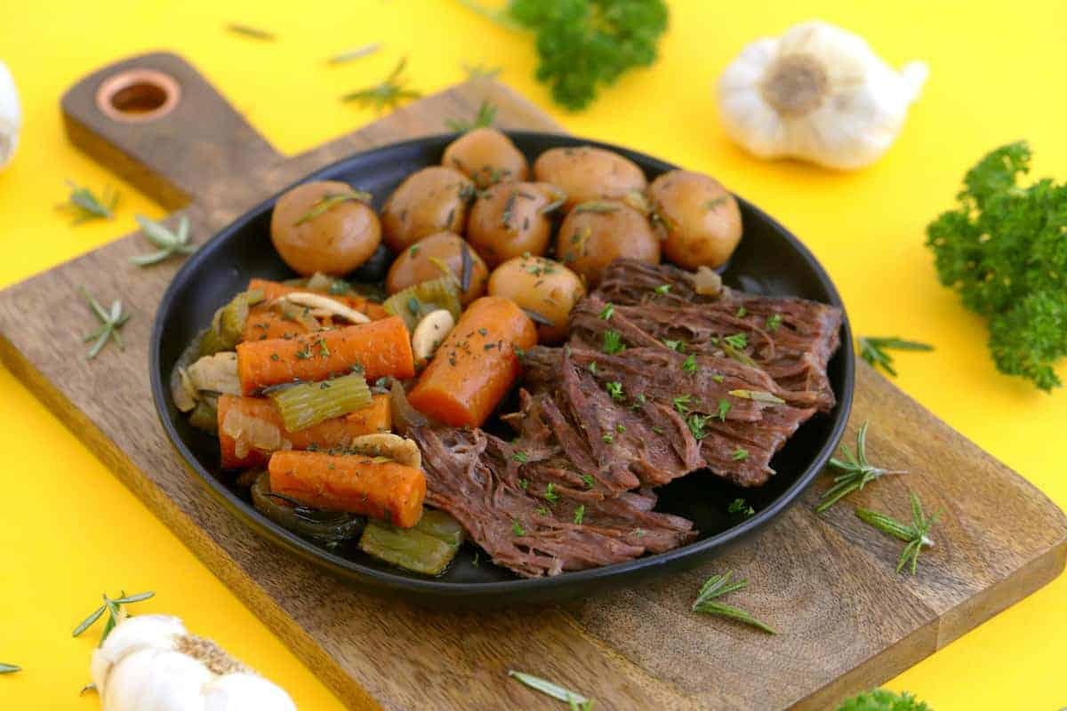 Dutch oven pot roast recipe, how to cook a pot roast in the oven, beef pot roast, pot roast dinner, pot roast with potatoes and carrots, crock pot roast, healthy dinner ideas, pot roast in oven, healthy one pot meals, paleo pot roast