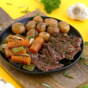 Dutch oven pot roast, slow cook pot roast in oven, how to cook a pot roast, slow cooker pot roast, beef chuck pot roast, healthy pot roast, pot roast oven with potatoes and carrots, one pot meals, easy weeknight meals, whole30 pot roast