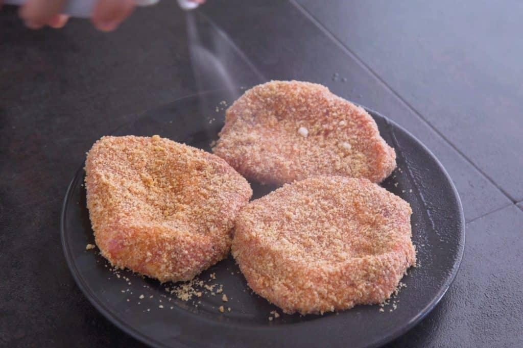 Spray before cooking pork chops in air fryer