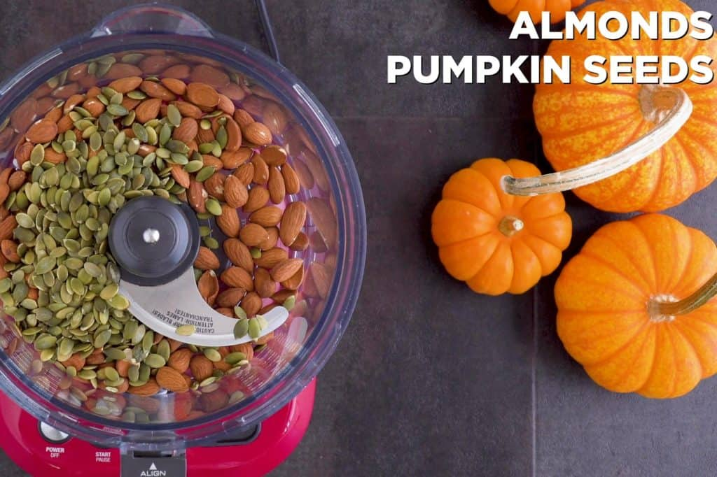 Pulse almonds and pumpkin seeds in food processor until finely chopped.