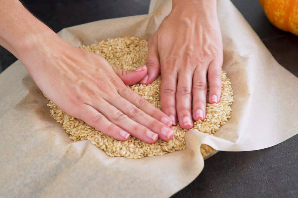 Cover crust with a sheet of parchment and pie weights, dry rice, or dry beans.