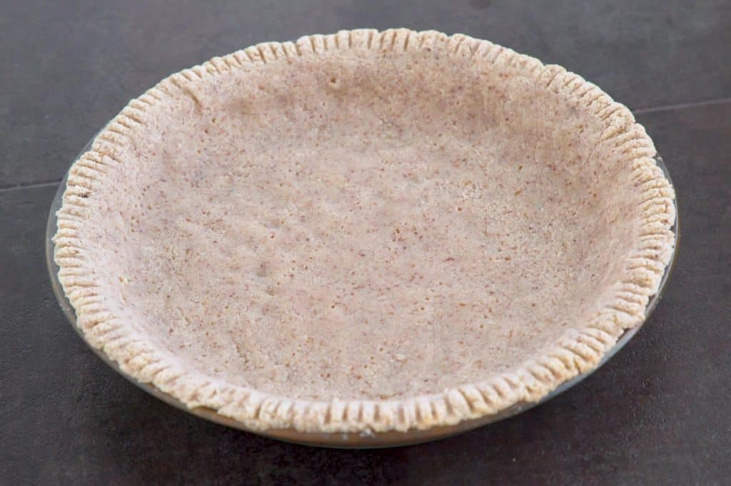 Prebake low carb pumpkin pie crust at 325°F (160°C) for about 12 minutes.