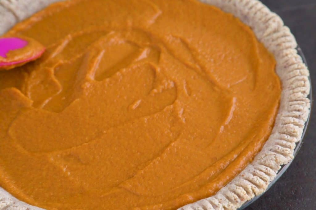 Pour filling onto cooled pie crust, spreading into an even layer.