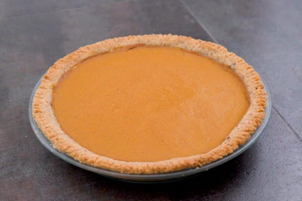 Bake vegan keto pumpkin pie at 325°F (160°C) for about an hour.