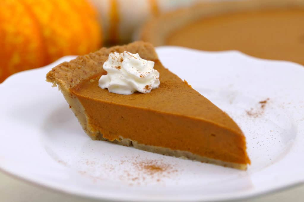 Vegan Keto Pumpkin Pie topped with Coconut Whipped Cream