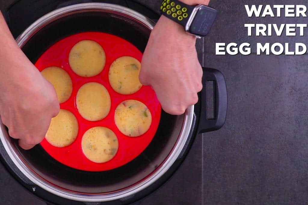 "Add water, metal trivet, and filled egg bites mold into instant pot. Cook on ""steam"" setting for 8 minutes."
