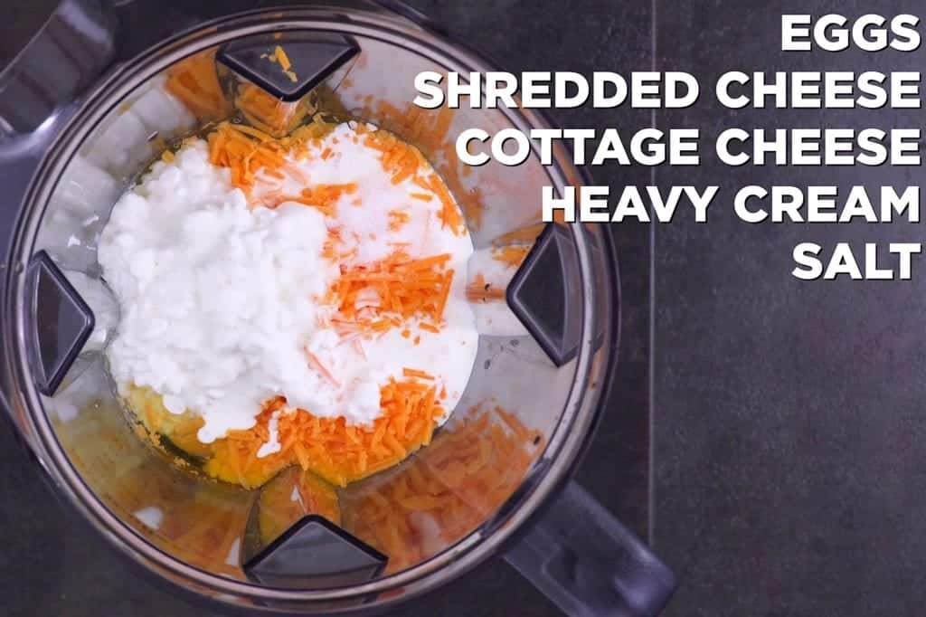 Add cheesy egg mixture ingredients to a blender