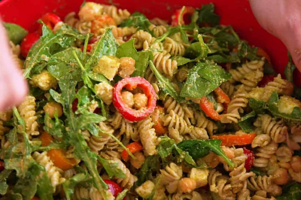 Add all gluten free pasta salad ingredients to a bowl and toss to combine.