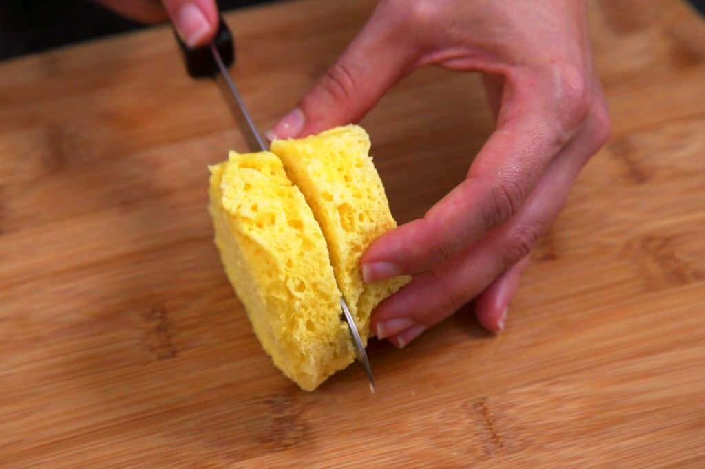Allow keto biscuit to cool slightly before slicing in half