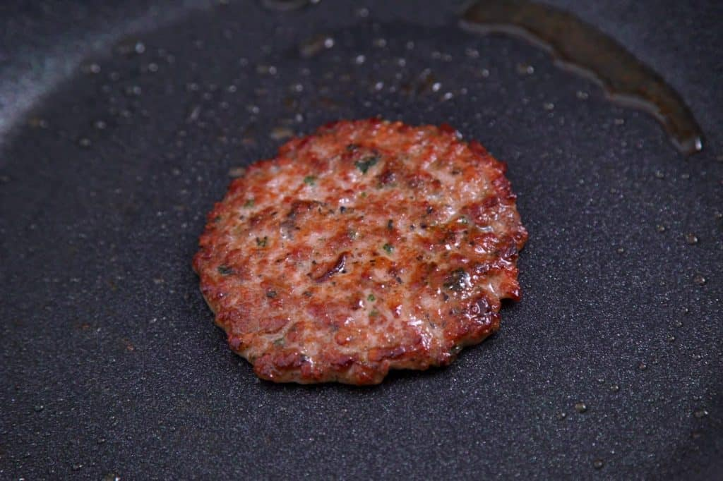 Cook breakfast sausage patties, flattening with spatula as you cook