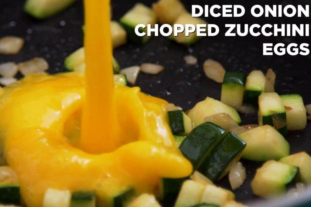 Saute veggies until tender, then scramble eggs.