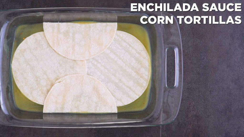 Add a layer of enchilada sauce to cover bottom of dish, followed by a layer of corn tortillas.