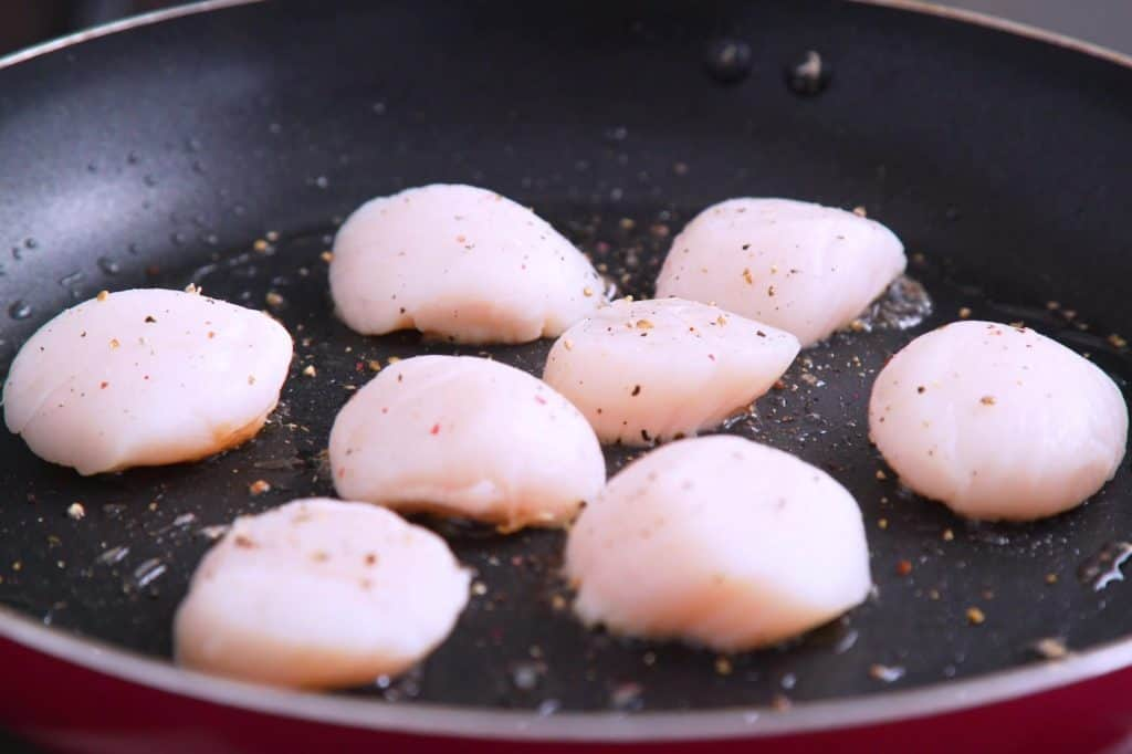 How to pan sear scallops in bacon fat, seasoning to taste.
