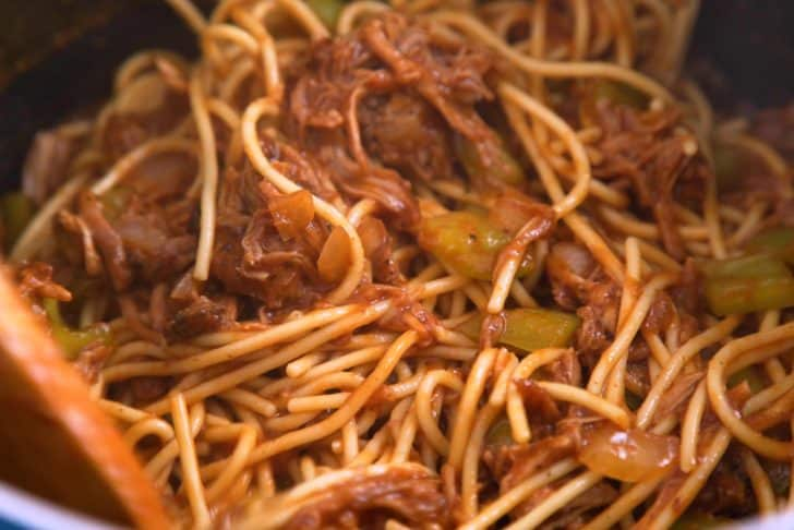 Add cooked spaghetti noodles and toss well to coat.