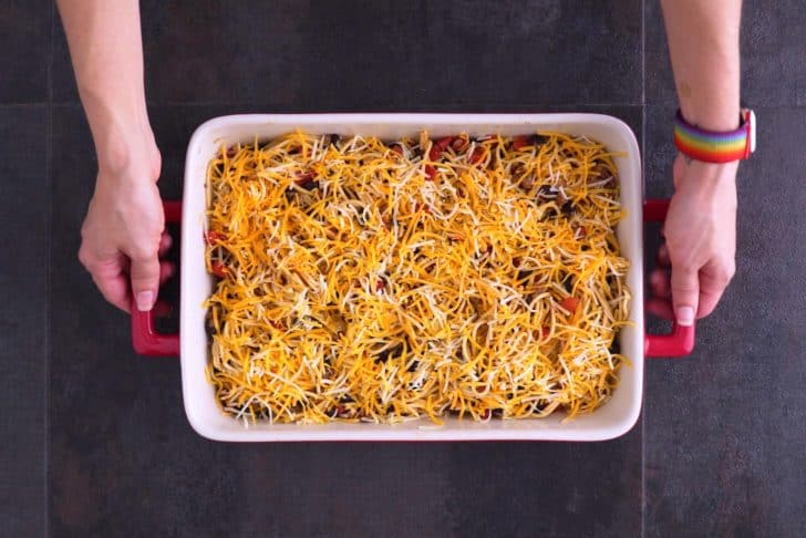 Transfer to a casserole, top with cheese, and bake for 25 minutes.