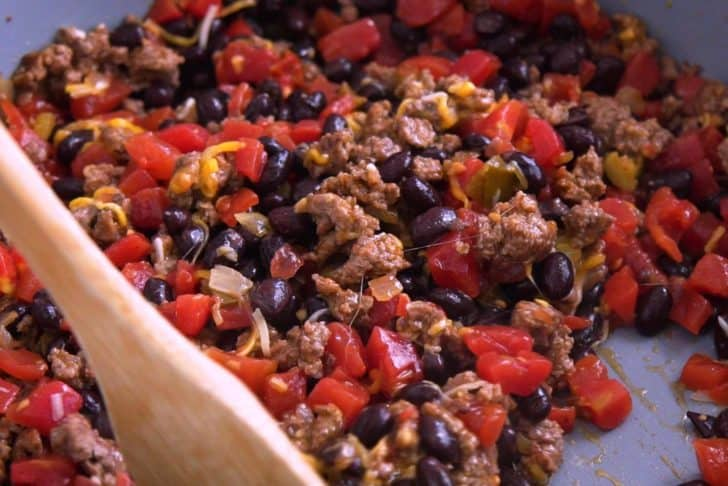 Cook meat and bean mixture with your favorite taco fillings.