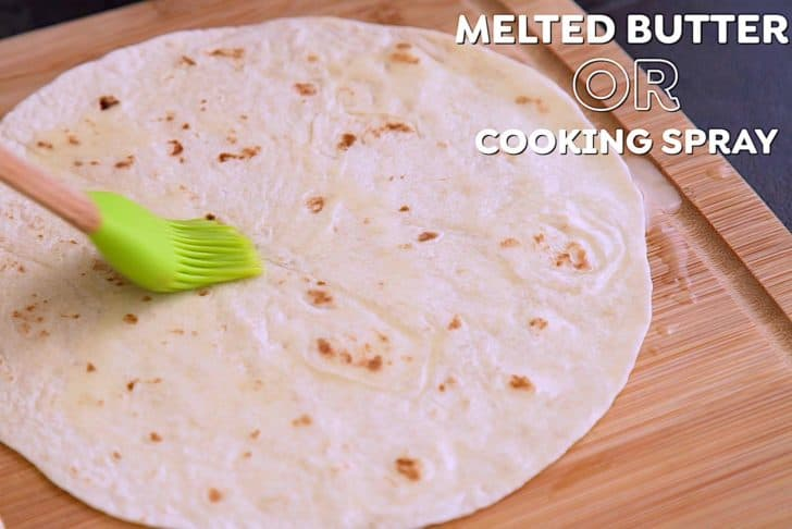 Brush one side of tortilla with melted butter or spray lightly with cooking spray.