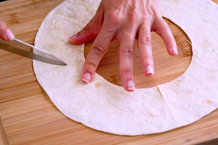 Cut flour tortillas into desired shapes for cinnamon sugar chips.