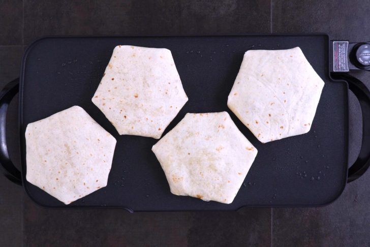 Cook crunchwraps seam-side down on the griddle over medium-high heat (350°F) for 3-5 minutes on each side.