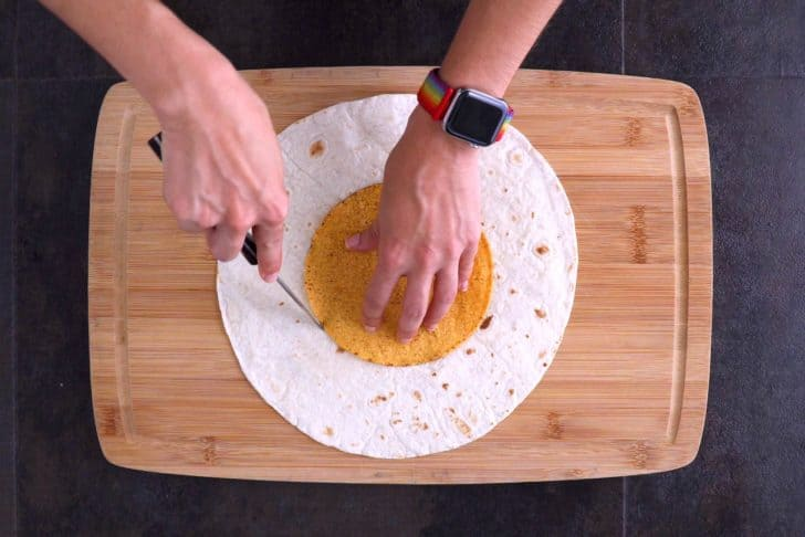 Use tostada shell as a mold to cut small tortilla circles out of half of your larger tortillas.