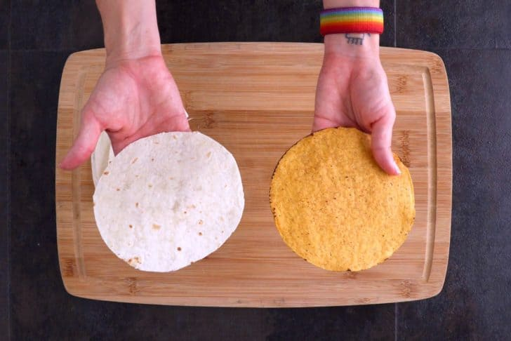 Use a tostada shell as a mold to cut small tortilla circles out of half of your large tortillas.