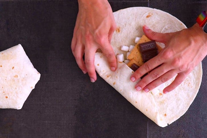Fold in the edges of the tortilla towards the center.