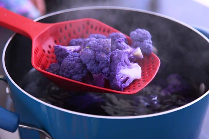 Blanch purple cauliflower separately because its purple color will leach into the water and onto your other veggies!