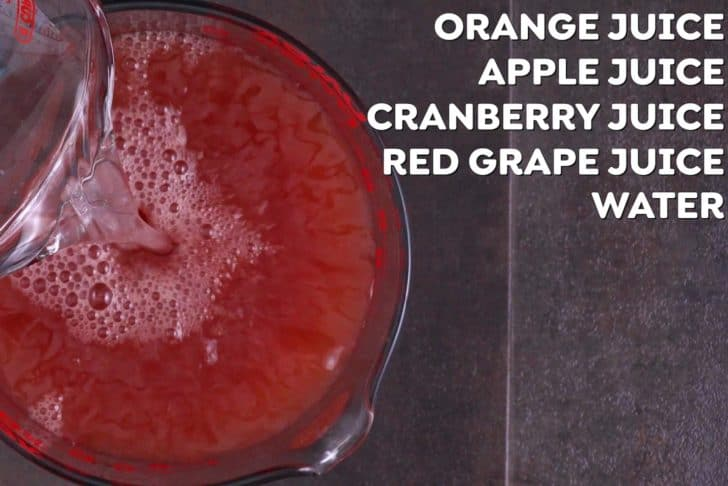 Combine all fruit juices and water for red Halloween punch in a large pitcher. Chill in the fridge for 1 hour before serving.
