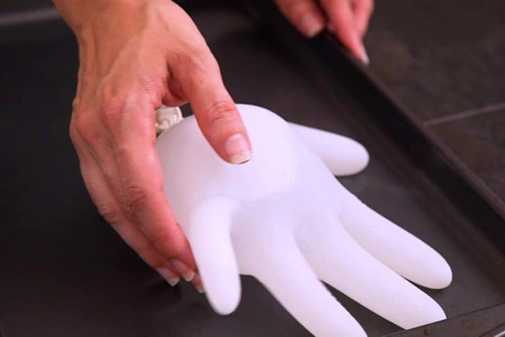 Pour tonic water into food safe gloves and tie them off like water balloons. Lay flat on a tray and freeze for 3-4 hours.